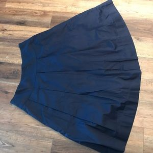 New with tags!  Navy midi pleated skirt!  Size 16
